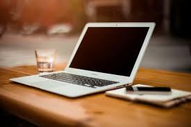 office desk photo. Laptop On Office Desk Free Photo