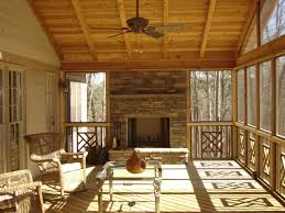 screened in deck with built in fireplace