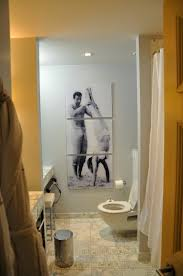 amusing bathroom wall tiles design. Bathroom. Interesting Bathroom With Human Picture On The Wall And White Latrine Also Cream Tile Amusing Tiles Design
