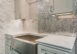 Reflective, metallic kitchen backsplash tile - Stainless Steel Penny Round  Metal mosaic tile https:
