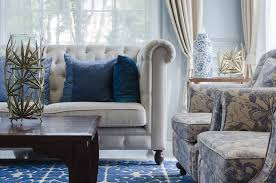 floral living room furniture. close up of furniture pieces in living room with pleated couch and floral pattern chairs r