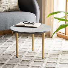 Instantly upgrade any living room with the natural beauty of this stunning round concrete coffee table. Cof9001a Coffee Tables Furniture By Safavieh
