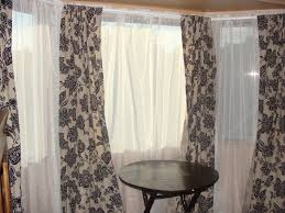 Living Room Bay Window Treatment Top Window Curtain Ideas On Interior With Window Dressing For Bay