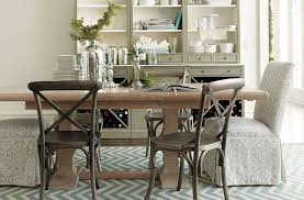 this neutral dining room uses an outdoor rug making spills easy to clean using outdoor rugs indoors