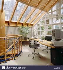 black home office. Black Leather+chrome Swivel Chair At Desk In Eighties Home-office Conservatory Extension With Glass Roof Home Office S