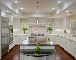 Example of a classic u-shaped dark wood floor kitchen design in San  Francisco with