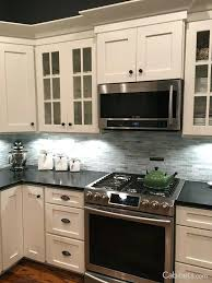maple kitchen cabinets with black appliances. Images Of Kitchen Cabinets The Picture Features Shaker Ii Maple Bright White . With Black Appliances L