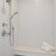 floating shower bench over marble hexagon tiles