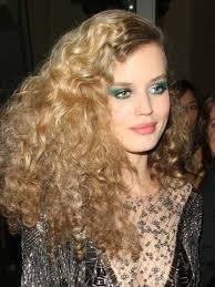 georgia may jagger works 70s disco hair and bright green make up at party with