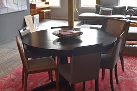 60 solid round wood dining table with 2 leaves consignment