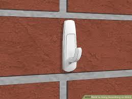 image titled hang something on brick step 11