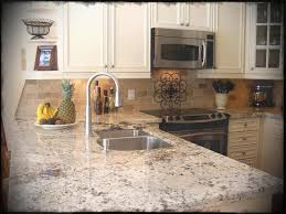 image of white kitchen cabinets black countertops backsplash off with dark granite the