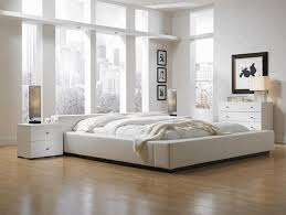 white ceiling fan in bedroom. bedroom rustic chains of lamp comfy dark blue pillow white padded bed headboard wide cubical ceiling fan in s