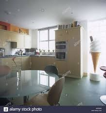 Dining Area With A Circular Glass Table In Kitchen With A Large Ice