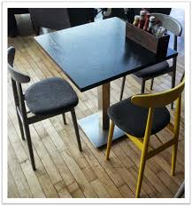 working closely with the architects defrae provided bespoke seat pads on both the uber contemporary kitty side chairs and kent bar stools also staining