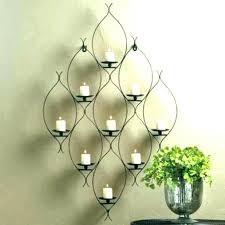 silver metal leaf wall art with tea light holders