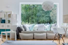 Light grey couch Tufted Sectional Grey Sofa Loaded With Light Blue White And Grey Pillows Mix Of Solid Home Stratosphere 35 Sofa Throw Pillow Examples sofa Décor Guide Home Stratosphere