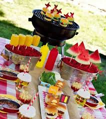 Backyard BBQ table - love the corn and watermelon on skewers in metal bins,  and paper cupcake holders inverted over drinks to keep bugs out.