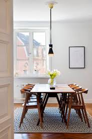 mid century modern dining room with a wood dining table diningroominspiration homedecor