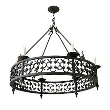 large round wrought iron chandelier with modified fleur de lis pattern detailing for