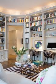 really like the spot lights above the bookcases look like theyve added deep crown molding to create it bookcase lighting ideas