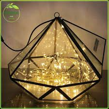 gold geometric candle holder terrarium