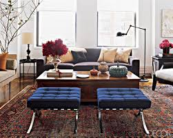 a more modern space from elle decor where the designer married a traditional rug with more streamlined furniture and accessories elledecor