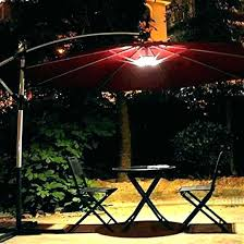 11 ft patio umbrella with solar lights cantilever tilt in sand light netting offset led