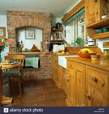 Exposed Brick Kitchen Pine Fitted Cupboards In Country Kitchen With Oven In Exposed