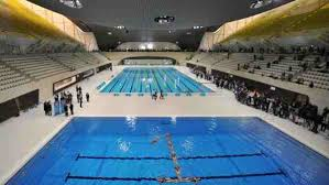 olympic swimming pool 2012. Members Of A Synchronised Swimming Team Form The Shape Number \ Olympic Pool 2012 O