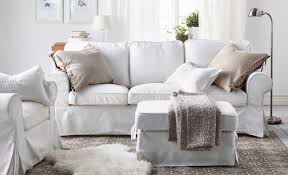 ikea white living room furniture. a living room with white sofa and arm chair beige light brown cushions ikea furniture