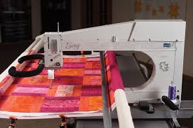 Lucey longarm quilting machine   APQS & Lucey Front of Machine Adamdwight.com