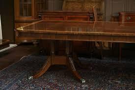 satinwood banded henredon dining table on birdcage pedestals