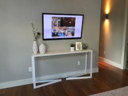 white table and wall mounted tv