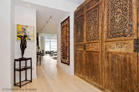 antique caucasian talish rug placed on the wall effortlessly harmonizes diverse art and architectural elements