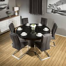 large round black oak dining table 6 extra padded comfy grey chairs
