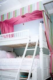 I've never seen a canopy over bunk beds before, but it's really ...