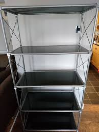 matching freestanding glass shelving unit and tv stand