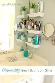 bathroom over sink shelf bathroom organization s a girl and a glue glass shelf above