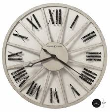 625571 metal oversized wall clock features heavily seeded antique glass panels