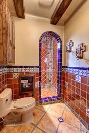 Could do fancy tiles like this in shower bathroom. Spanish delight -  mediterranean - bathroom - other metro - by Professional Design Consultants