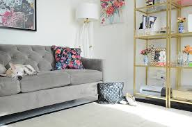 white office decors. Tufted Gray Sofa And Lucite Gold Floor Lamp In A Bright White Office Space. Decors