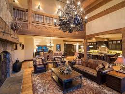 Ski chalet furniture Interiors This View 0f The Living Room Highlights The Massive Stone Fireplace With Natural Wood Mantle On Home Stratosphere Log And Stone Colorado Ski Chalet With Great Room