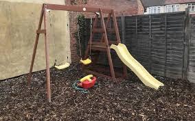 plum wooden double swing slide set