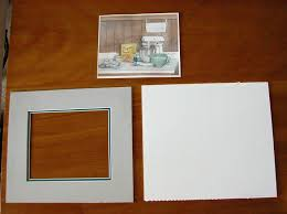 these are the items i am assembling for the contents of my frame mat board cut to the proper size with a window cut out for the art to show through