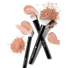 three b makeup brushes with swatches of foundation and powder