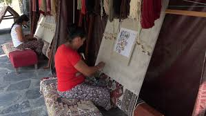 ephesus turkey sept 2016 ephesus turkey women hand weave knot turkish rug carpets and rugs whether hand knotted or flat woven are among the most well
