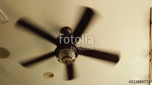a ceiling fan slowly turns with a wobbly cadence stock footage and royalty free s on fotolia com vid 212869772
