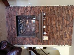 Fireplace remodel using realistic, lightweight faux stone veneer panels.
