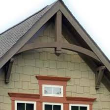 Home Exterior Decorative Accents brown wood gable arch with two gable bracket supports My Home 59